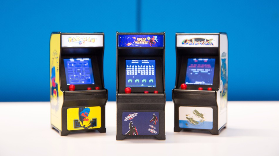 The tiny arcade cabinets let you enjoy three retro games